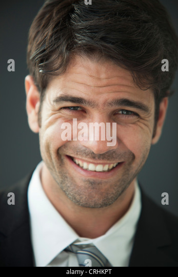 Man smiling happily, portrait - Stock Image