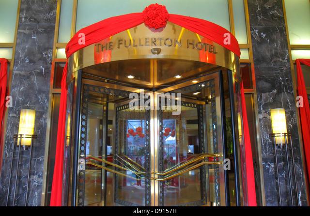 Singapore Singapore River Boat Quay The Fullerton Hotel front entrance decorated Chinese New Year revolving door - Stock Image