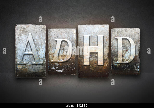 The letters ADHD written in vintage letterpress type - Stock Image