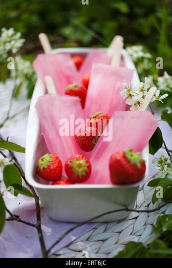 Pink popsicles with fresh strawberries - Stock Image