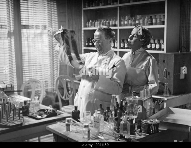 Doctor and nurse, 1930s - Stock Image