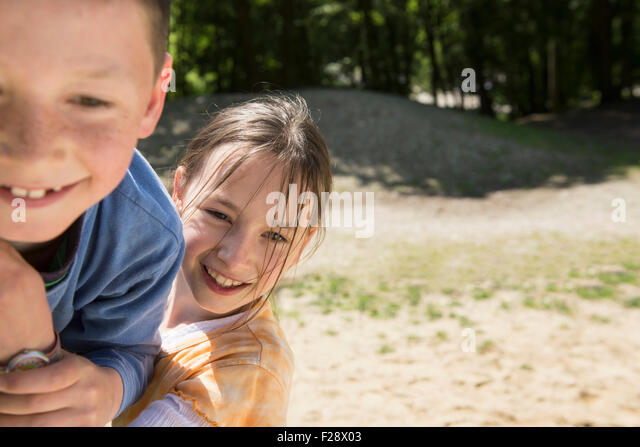 Boy and girl playing in playground, Munich, Bavaria, Germany - Stock Image