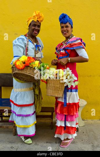 Cuban women wearing traditional dress Havana Vieja Cuba - Stock Image