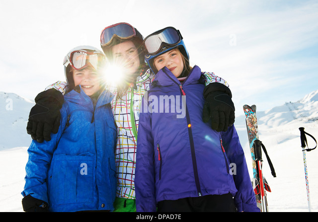 Portrait of brother and sisters in snow, Les Arcs, Haute-Savoie, France - Stock Image