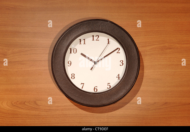 Brown clock - Stock Image