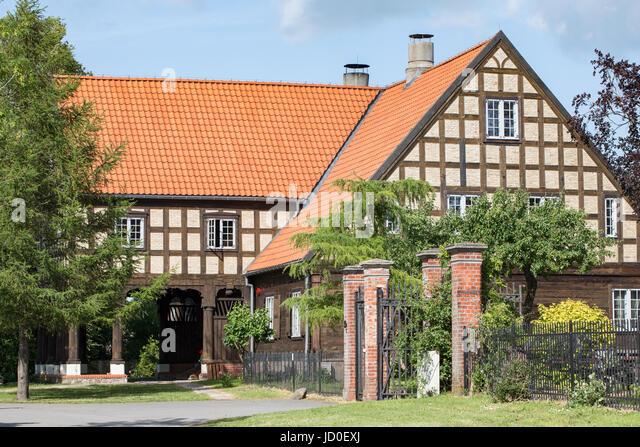 Arcade house (Vorlaubenhouse) in Marynowy (Marienau), Pomerania, Poland. A rare architecture art, with many wooden - Stock Image
