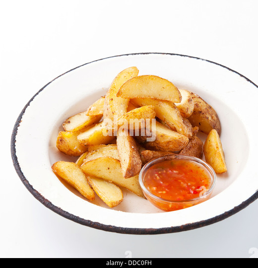 Fried potato 'country-style' with sauce - Stock Image