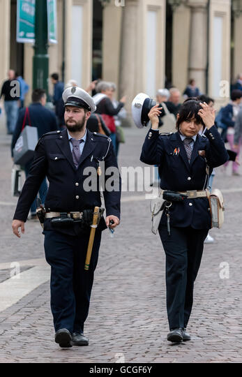 Two cops patrolling a street in Turin, Italy - Stock Image