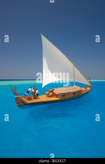Sailing with traditional dhoni, Maldives, Indian Ocean, Asia - Stock Image