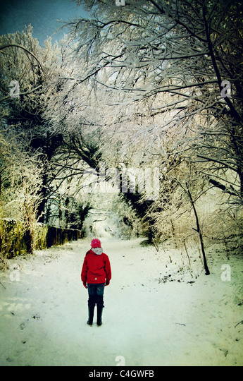 girl in red jacket in the snow - Stock-Bilder