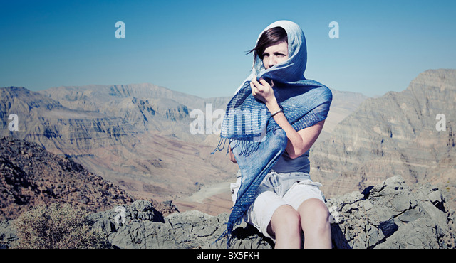 Shot of a Woman in Head Scarf in Omani Mountains - Stock Image
