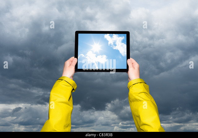 Child viewing storm on tablet computer - Stock-Bilder