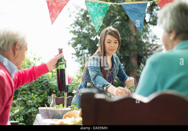 Family having lunch outdoors - Stock Image