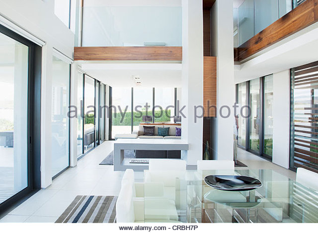 Dining room and open floor plan in modern house - Stock Image