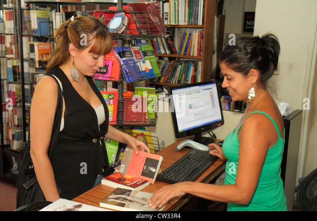 Mendoza Argentina Avenida San Juan Hispanic business bookstore shopping publishing shelf shelves display books sign - Stock Image