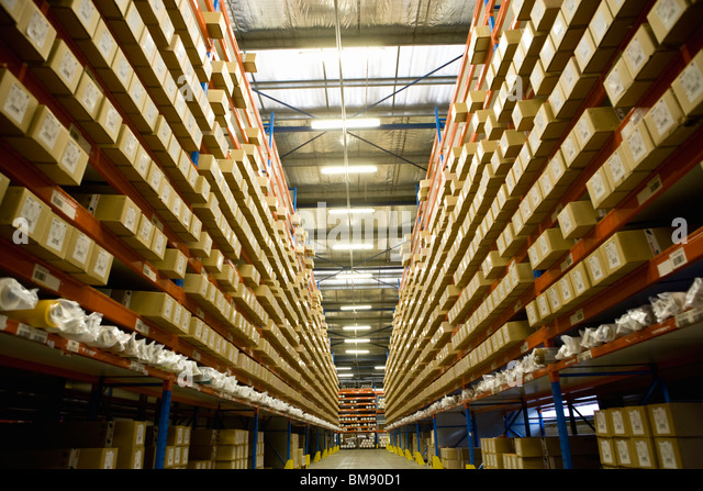 Warehouse stocked with coated textile products - Stock Image
