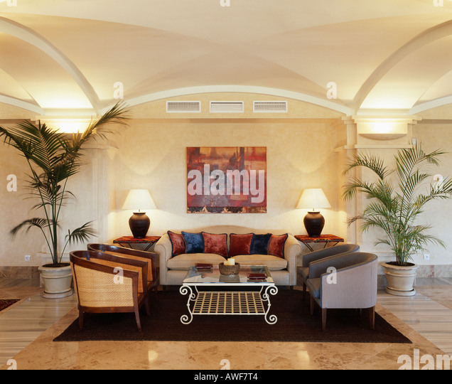 Comfortable Sofa And Armchairs In Modern Spanish Living Room With