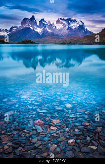 Sunset over Lago Pehoe and the Los Cuernos peaks in Torres del Paine National Park, Patagonia, Chile - Stock Image