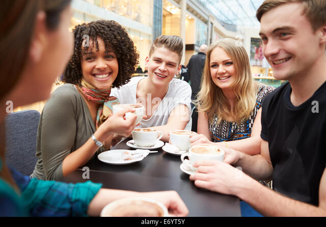 Group Of Young Friends Meeting In Café - Stock Image
