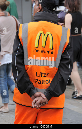 McDonalds Litter Patrol fast food waste litter street cleaners branding corporate responsibility dustcart street - Stock Image