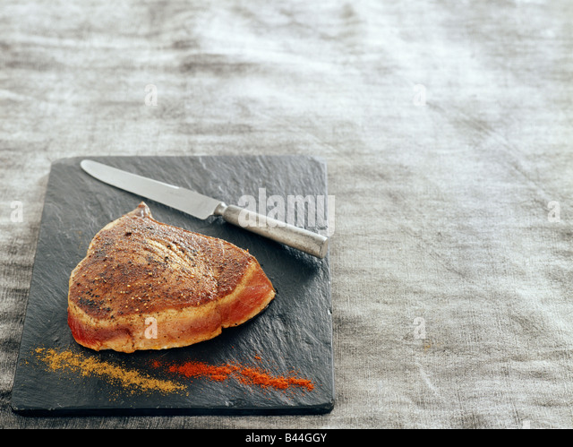 Medium-cooked slab of tuna with mild spices - Stock Image
