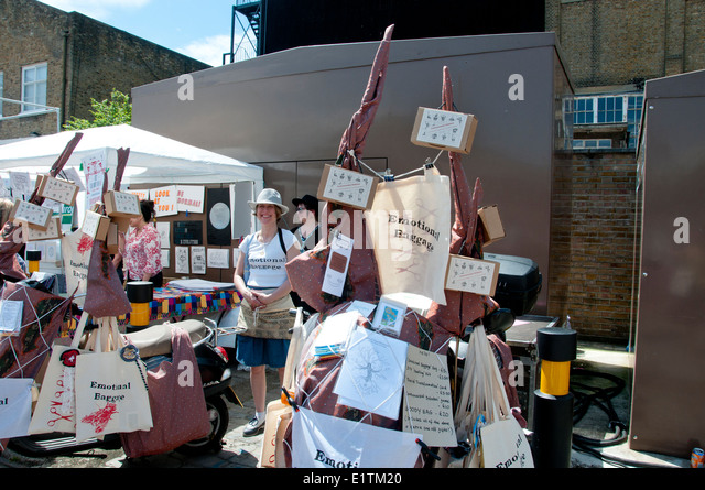 Buxton St off Brick Lane, East London. June 8th 2014. Vauxhall Art Car Boot Fair. Barley Massey and her Emotional - Stock Image