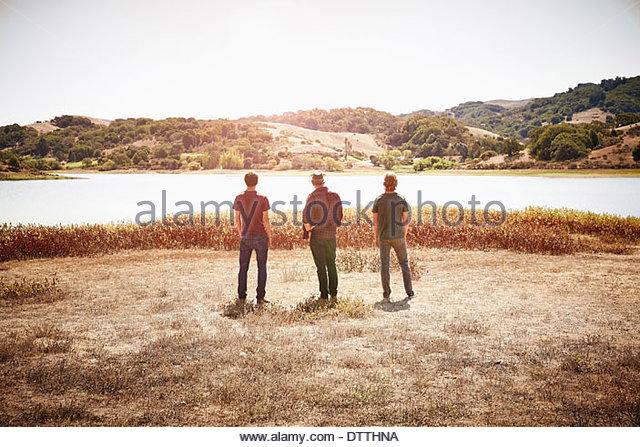 Men walking in park - Stock Image