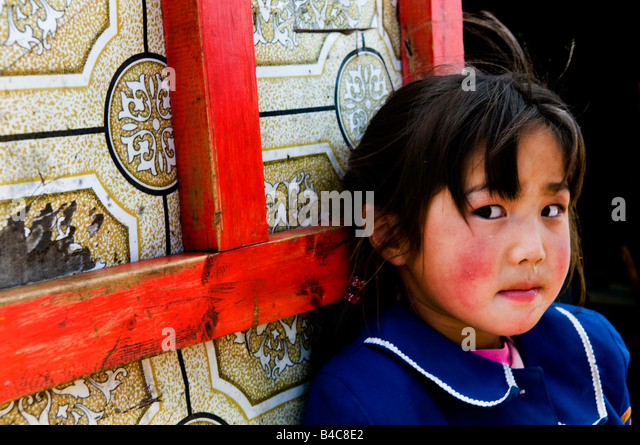 A cute Mongolian girl stands next to her family Ger ( traditional Mongolian home ) - Stock-Bilder