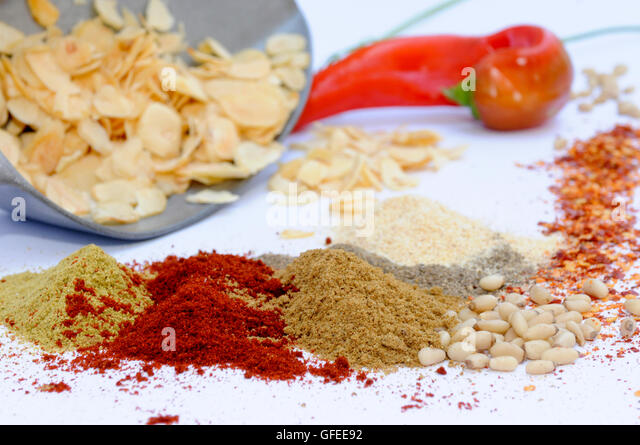 Still life of herbs and spices on white table - Stock Image