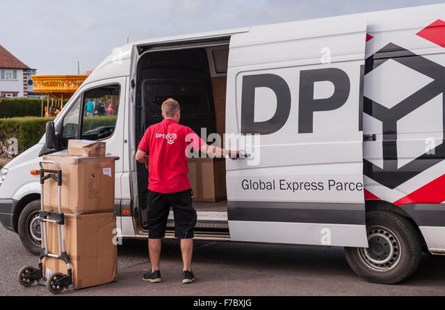 A DPD delivery driver delivering parcels  in Southwold , Suffolk , England , Britain , Uk - Stock Image
