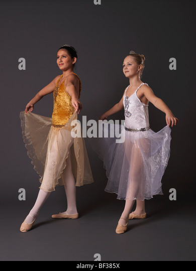 Two ballerinas facing camera left. - Stock Image