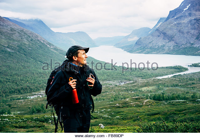 Sweden, Lapland, Kaitumjaure, Kungsleden, Male hiker in mountain valley - Stock Image