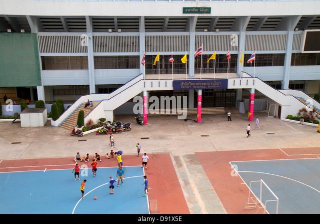 Thailand Bangkok Pathum Wan Rama 1 Road National Stadium soccer football players - Stock Image