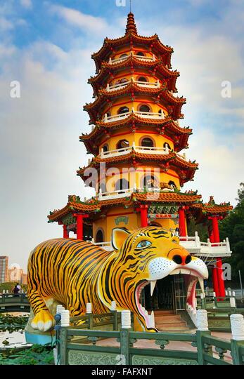 Dragon and Tiger Pagodas at night, Lotus Pond, Kaohsiung, Taiwan - Stock Image