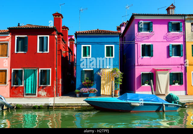 Colored houses in venetian city Burano, Italy - Stock Image