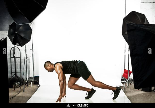 Sprinter at photo shoot - Stock Image