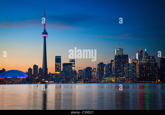 Downtown Toronto skyline, including CN Tower and Rogers Center, as seen in the early evening - Stock Image
