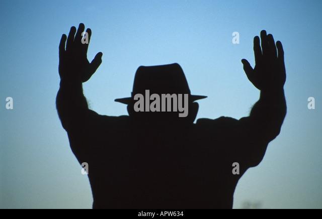 New Jersey silhouette man hat hands raised Mafia - Stock Image