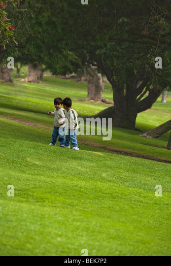 Two boys playing in a park - Stock-Bilder