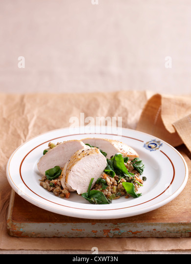 Plate of chicken and lentils - Stock Image