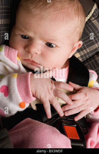 A Baby Buckled Into A Car Seat; Millet, Alberta, Canada - Stock Image