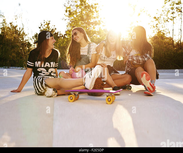 Best friends hanging out on the streets, summer and sunflare - Stock Image