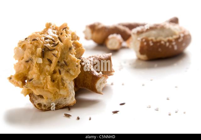 Pretzel with bavarian obatzda cheese - Stock-Bilder