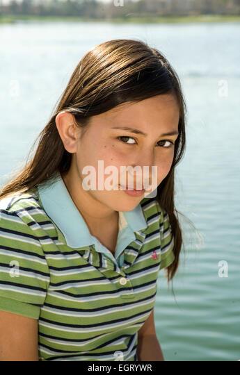 Teenage Vietnamese/Caucasian girl 11-13 year years old looking camera multicultural multi racial interracial racially - Stock-Bilder