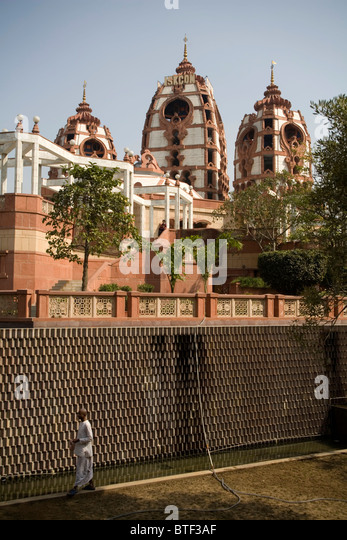 Hare Krishna devote praying in the garden of Iskon Temple, Delhi, India. - Stock Image