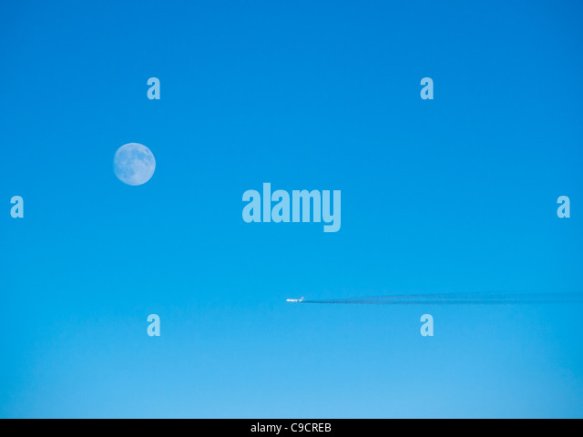 An airplane and the moon - Stock Image