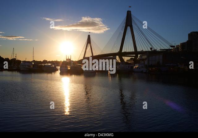 Glebe Island Bridge & Johnstons Bay, Pyrmont Sydney at sunset - Stock Image