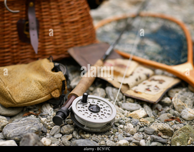 Fishing equipment by the river - Stock Image