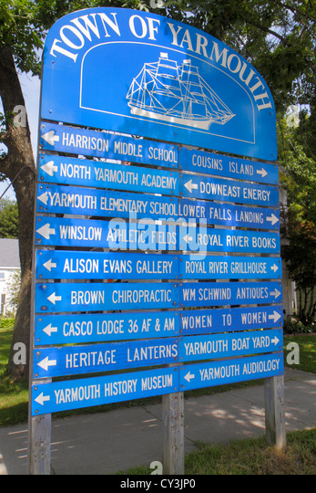 Maine Yarmouth Main Street Town of Yarmouth sign directional information businesses arrow direction - Stock Image