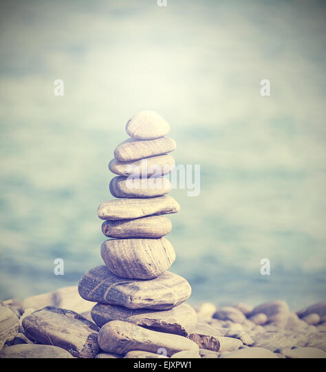 Retro filtered heap of stones, Zen spa concept background. - Stock-Bilder